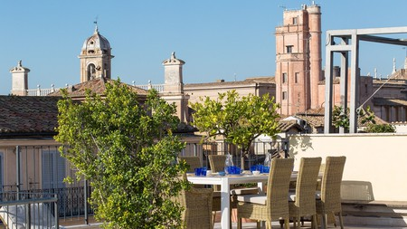 Admire the amazing view from the rooftop terrace of the Piazza Venezia