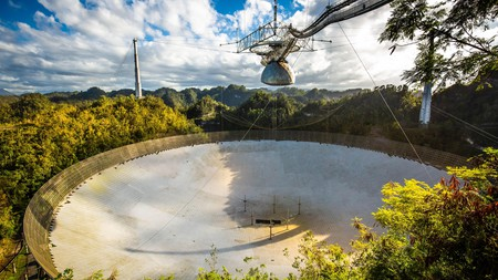 The large radio telescope dish at Arecibo national observatory