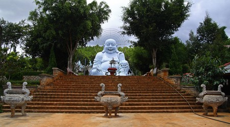 The Happy Buddha statue sits at the core of the Linh An Tu pagoda near Dalat