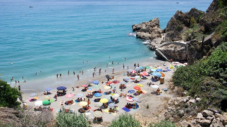 Pick a sheltered spot on one of the small beach coves in popular Nerja on the Costa del Sol
