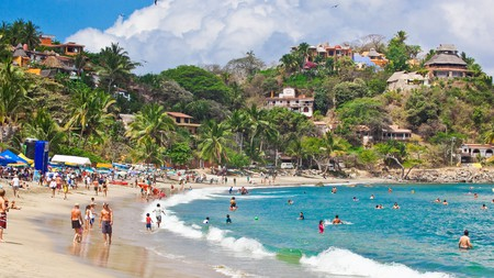 Sayulita village tumbles down the forested Sierra Madre hillsides to golden beaches and the pounding Pacific