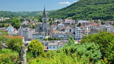 Lourdes as seen from a hilltop during summertime