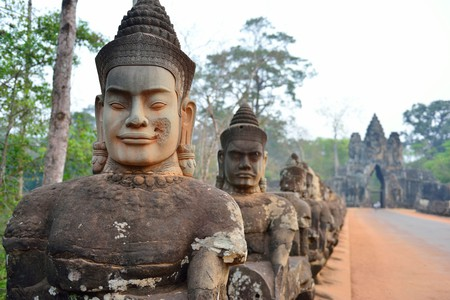 Statues of ancient gods line the road in front of Angkor Thom in Siem Reap, Cambodia