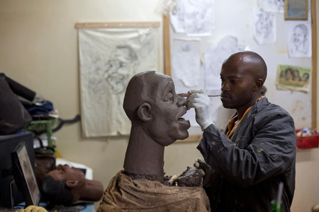 Puppet maker Im Muchemi works on a clay mould at the GoDown Arts Centre