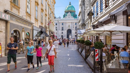 Life in Vienna is drenched in culture and the arts; here, a restaurant-lined street leads to the Hofburg palace
