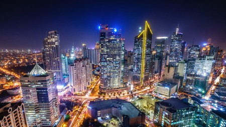 Check out the buzzing bars and clubs and bright city lights of Makati in Manila, the capital of the Philippines