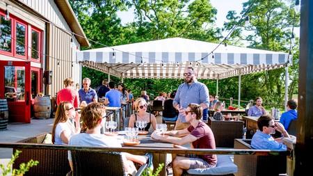 Guests enjoy drinks on the front deck at Lieb Cellars-Bridge Lane, Long Island