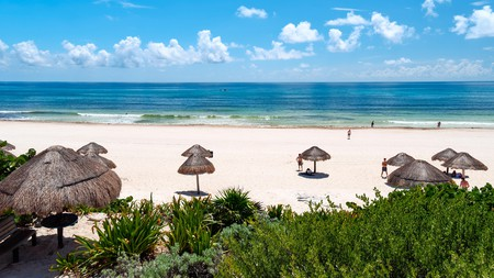 Relax in paradise at Playa Delfines, and admire rolling waves from a sun lounger