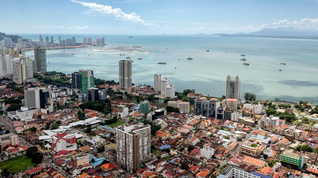 Penang's capital, George Town, overlooks the Strait of Malacca