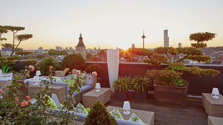 Enjoy the sunset from the rooftop terrace at the Savoy in Cologne, Germany