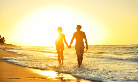 Spend your romantic honeymoon in Oahu and stroll hand in hand down the beach at sunset