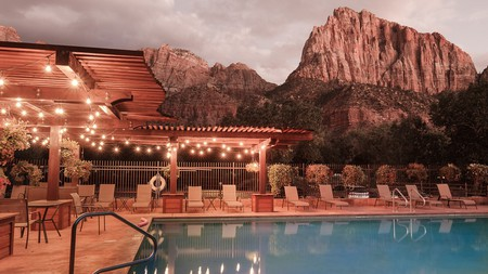 Enjoy poolside views of Zion National Park at the Cable Mountain Lodge in Utah