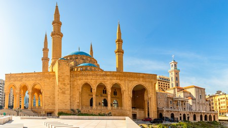 Central Beirut's Mohammad Al-Amin Mosque and Saint Georges Maronite cathedral rub shoulders on a summer morning