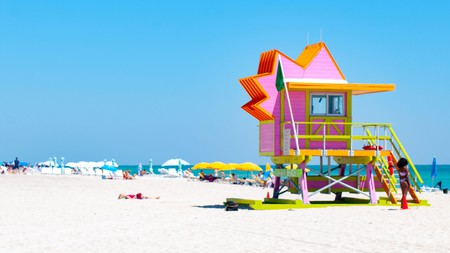Miami Beach's iconic Art Deco lifeguard towers against a blue Florida sky.
