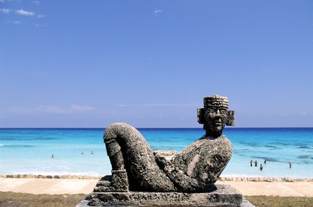 Chac Mool, the Mayan rain god, is immortalized in stone on the beach in Cancún