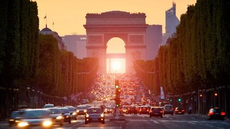The Arc de Triomphe towers over the iconic Champs-Élysées
