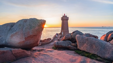 The pink granite lighthouse of Ile Louët sits by the Château du Taureau offshore fortress in pretty Morlaix Bay