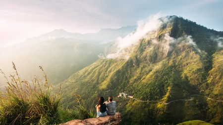 The couple traveling in the Serpentine in the mountains in Sri Lanka