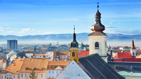 The old town of Sibiu offers both stunning architecture and beautiful mountain scenery