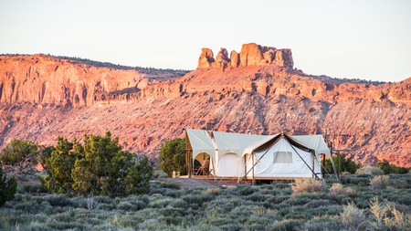 Go glamping with Under Canvas Moab for magnificent views of red rock canyons, mesas, and buttes, and the ultimate stargazing experience in Utah