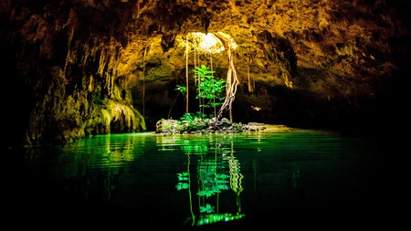 Dive into Cenote Dos Ojos and explore stalactites and stalagmites from the fresh water