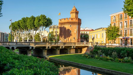 Le Castillet is the former city gate that serves as the entrance to Perpignan old town