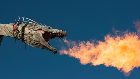An escaped fire-breathing dragon sits on top of Gringotts bank at the Wizarding World of Harry Potter in Universal Studios Florida