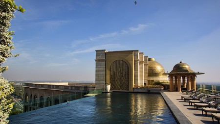 The Leela Palace in New Delhi is a luxurious hotel featuring traditional tapestries and regal chandeliers
