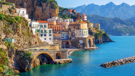 The Amalfi Coast is a stunning combination of limestone cliffs, golden-hued coves, cobbled villages and crystal-clear waters