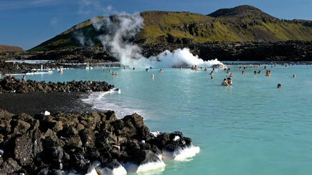 Bathe in the warm milky-blue geothermal waters of the Blue Lagoon, Iceland, whatever the weather