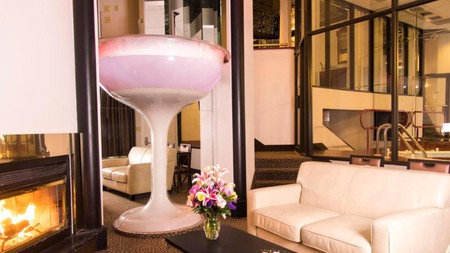 For an unforgettable stay at the Cove Haven Resort, book a suite with a champagne glass whirlpool