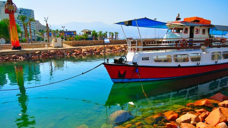 When visiting Eilat, take a glass-bottom boat tour to explore the Red Sea