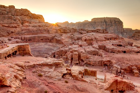 Watch the sunset over the tombs and amphitheatre in Petra, Jordan