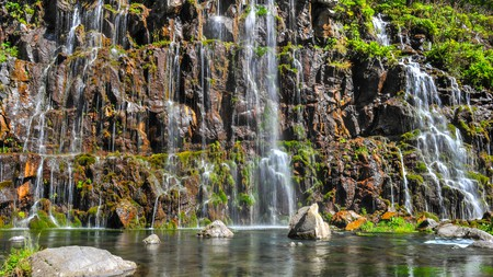 Dashbashi Canyon is a mountain gorge of tumbling waterfalls and steep slopes covered by scattered foliage