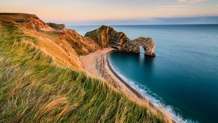 Seeing Durdle Door from a clifftop path is just one of the charms of Dorset's Jurassic Coast