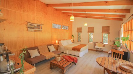 You'll find artisan wall hangings and wooden beams at the cozy Eco Lodge El Arbol