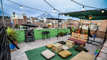 Head to the rooftop at hostel Econunay for city and volcano views