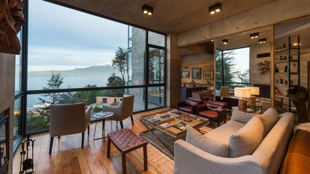 Floor-to-ceiling windows at Hotel AWA offer views over Llanquihue Lake and Osorno Volcano