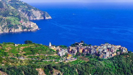 Corniglia village sits perched on a clifftop overlooking the cobalt waters of the Mediterranean