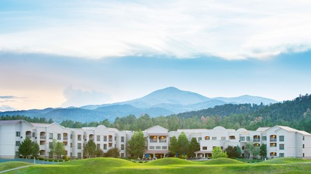 The course at MCM Elegante Lodge & Suites overlooks soaring misty mountains