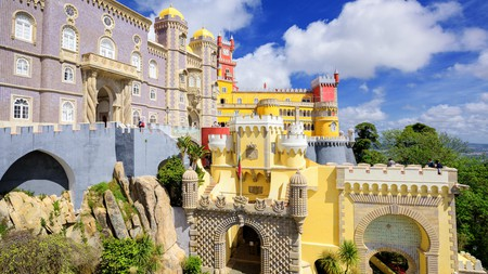 Sintra's iconic Pena Palace is a wedding cake-like vision perched atop a rocky outcrop
