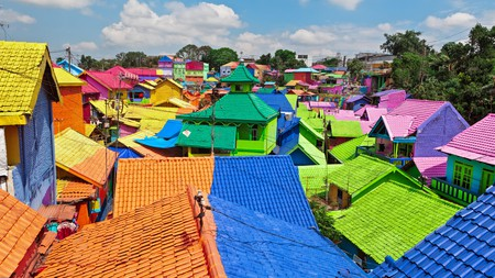 When in Malang, Indonesia, visit the colourful tiled roofs of Jodipan village