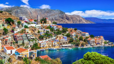Symi's Neoclassical harbour of pastel-coloured buildings welcomes you to the low-key, charming Greek island