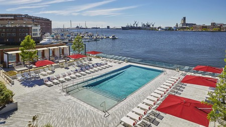 The historic Sagamore Pendry Baltimore boasts a pool overlooking the Inner Harbor and a myriad of luxury amenities including the Rec Pier Chop House restaurant, and aged whiskeys in the Cannon Room