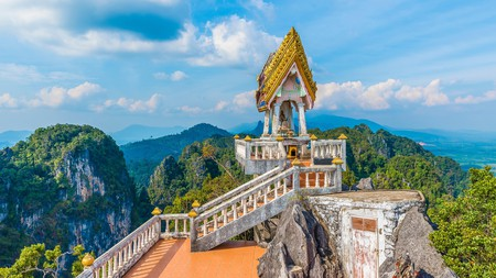 Tiger Cave Temple in Krabi is surrounded by scenic mountains