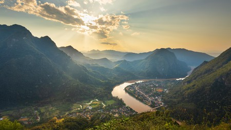 The Nam Ou, a tributary of the Mekong River, winds its way through the verdant Luang Prabang Province