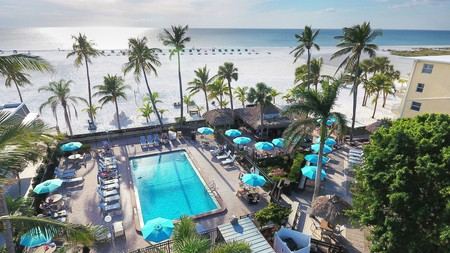 Keep an eye for the resident dolphin pods when you chill on a lounger at Outrigger Beach Resort