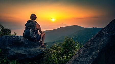 A backpacker enjoys the view of Da Nang Bay and the Ba Na mountains