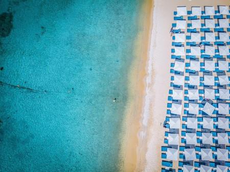 Enjoy Ornos Beach on Mykonos, Greece, from your shaded sun lounger