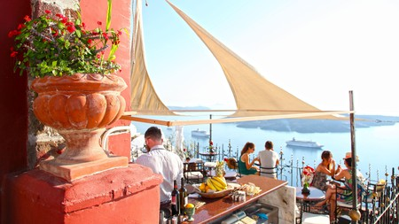 Enjoy cocktails with sea views at the PK Cocktail Bar in Fira, which is open 20 hours a day during peak season